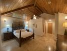 Meticulously kept Luxury Townhome in quiet gated community 5 minute walk to Grace Bay Beach/Pristine Pool and Gardens